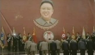 ** FILE ** North Korean leader Kim Jong-un and other officials bow before a portrait of the late leader Kim Jong-il during a ceremony to mark the 100th day after Kim's death at Kumsusan Palace in Pyongyang, North Korea, on Sunday, March 25, 2012. (AP Photo/KRT via AP Video)