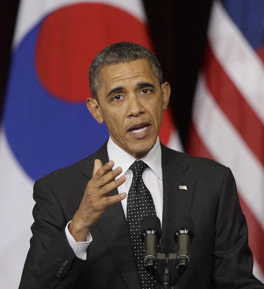 U.S. President Barack Obama delivers a speech at Hankuk University in Seoul, South Korea, Monday, March 26, 2012. (AP Photo/Lee Jin-man)