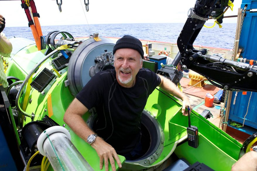 "James Cameron emerges from the Deepsea Challenger submersible on Monday after making a successful solo dive to the Mariana Trench, the deepest part of the Pacific Ocean. ""I felt like I literally, in the space of one day, had gone to another planet and come back. It's been a very surreal day,"" he said. (National Geographic via Associated Press)"