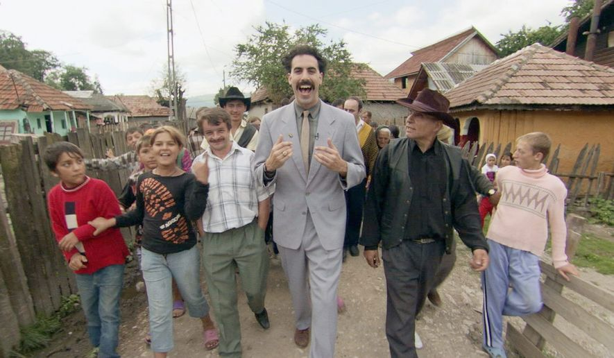 """This undated promotional photo, provided by Twentieth Century Fox, shows actor Sacha Baron Cohen, center, in a scene from the film """"Borat: Cultural Learnings of America for Make Benefit Nation of Kazakhstan."""" On Sept. 29, 2020, Amazon announced it would release its sequel to the 2006 film on its Amazon Prime streaming service prior to the U.S. general election. (AP Photo/Twentieth Century Fox)  **FILE**"""