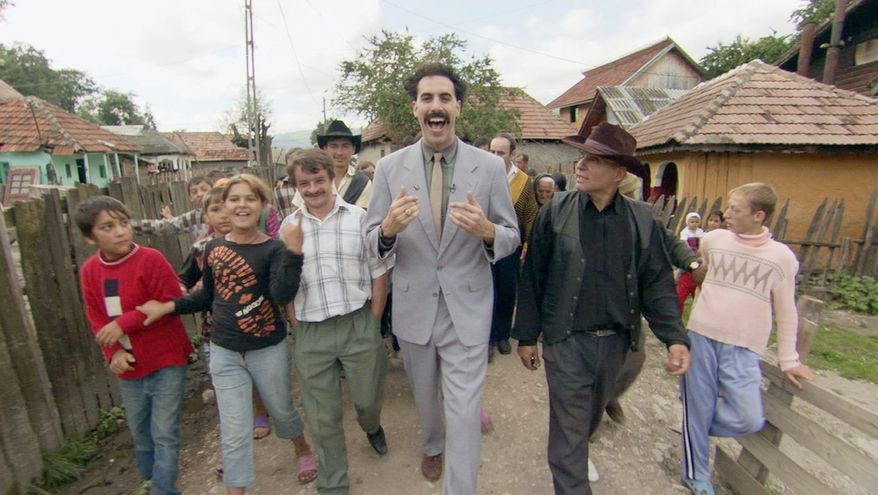 """This undated promotional photo, provided by Twentieth Century Fox, shows actor Sacha Baron Cohen, center, in a scene from the new film """"Borat: Cultural Learnings of America for Make Benefit Nation of Kazakhstan."""" (AP Photo/Twentieth Century Fox)"""