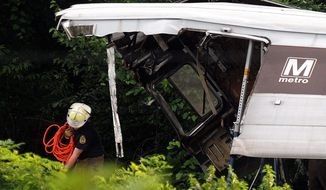 "Rescue workers arrive at the crash site where two Metro trains collided head-on near the Fort Totten Metro Station in June 2009. ""When the accident happened in 2009, I called a supervisor and said, 'Is this the one we all dreaded?' "" said Christine Townsend, who sued Metro for discrimination and won. (The Washington Times)"