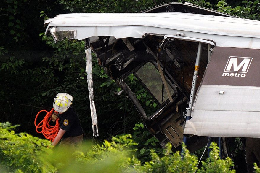"""Rescue workers arrive at the crash site where two Metro trains collided head-on near the Fort Totten Metro Station in June 2009. """"When the accident happened in 2009, I called a supervisor and said, 'Is this the one we all dreaded?' """" said Christine Townsend, who sued Metro for discrimination and won. (The Washington Times)"""