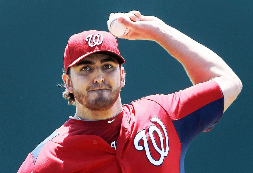 John Lannan went into spring training in three-way battle with Chien-Ming Wang and Ross Detwiler for the No. 5 sport in the Nationals' rotation. (Associated Press)