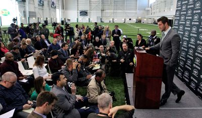 Quarterback Tim Tebow fields questions from more than 200 media members during his first news conference as a member of the Jets. (Associated Press)