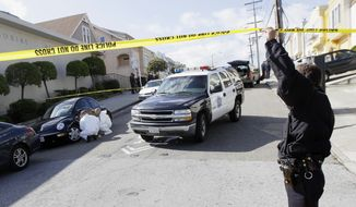 Police inspect outside of a house in San Francisco where five people were found dead on Friday, March 23, 2012. (AP Photo/Jeff Chiu)