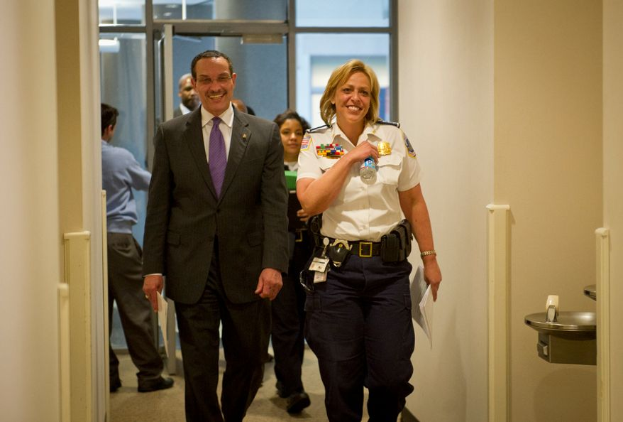 D.C. Mayor Vincent C. Gray (left) and Metropolitan Police Chief Cathy L. Lanier walk March 26, 2012, down a hallway to a press conference at the John A. Wilson Building in D.C., to announce an arrest in a March 11 anti-LGBT shooting at a IHOP restaurant in the city's Columbia Heights neighborhood. (Rod Lamkey Jr./The Washington Times)