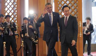 President Obama waves after being greeted by South Korean President Lee Myung-bak at the Blue House, the official presidential house, in Seoul on Sunday, March 25, 2012. (AP Photo/Susan Walsh)