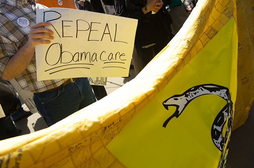 Members of the tea party rally March 26, 2012, against the Affordable Care Act outside the U.S. Supreme Court building in D.C., as the court hears oral arguments on the challenges to the Affordable Care Act. (Andrew Harnik/The Washington Times)