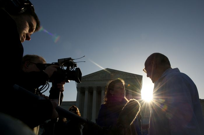 Dr. Michael Newman (right), a Washington internist who supports the Affordable Care Act, is interviewed by C-SPAN in front of the U.S. Supreme Court building in Washington on Monday, March 26, 2012, as the court hears oral arguments on challenges to the law. (Andrew Harnik/The Washington Times)
