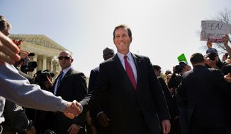 Republican presidential candidate Rick Santorum leaves after speaking to reporters in front of the U.S. Supreme Court building in Washington on Monday, March 26, 2012, as the court hears oral arguments on the Affordable Care Act. (Andrew Harnik/The Washington Times)