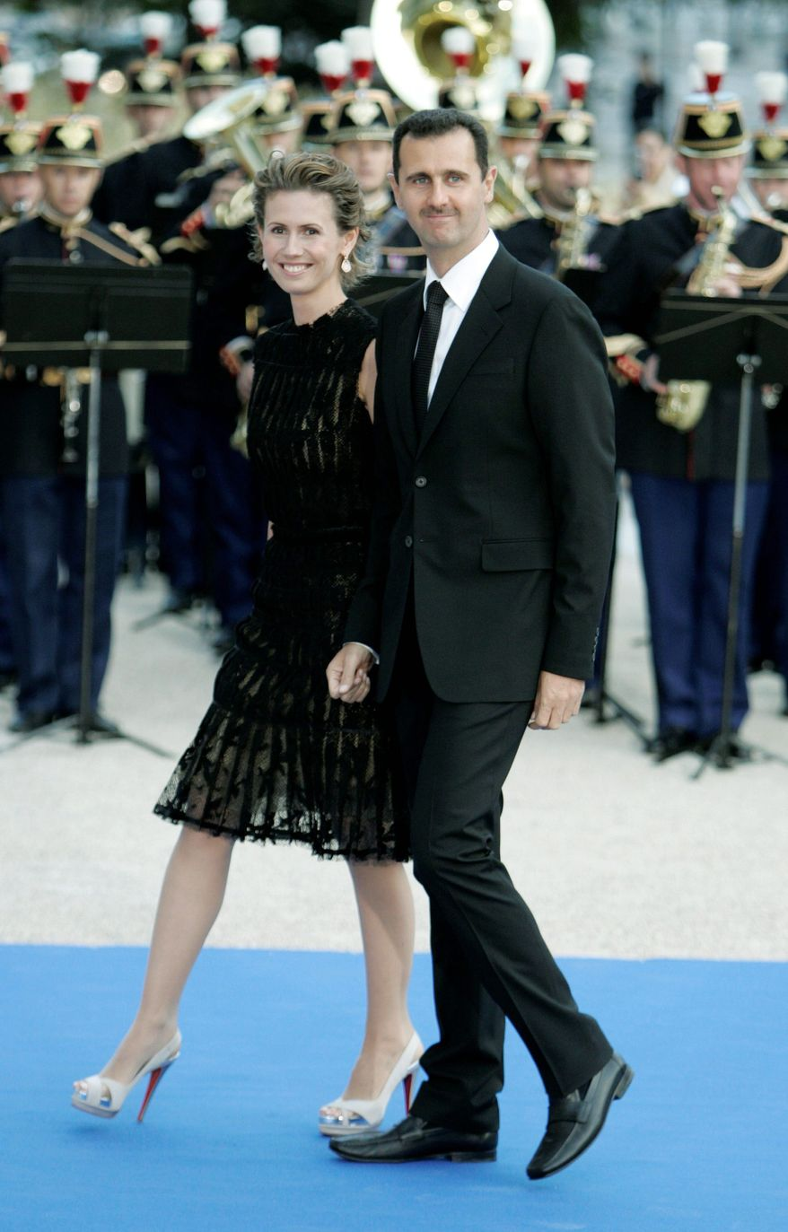 Syrian President Bashar Assad and wife Asma arrive for a formal dinner after a Mediterranean summit meeting in July 2008 at the Petit Palais in Paris. As Syria's bloodshed worsens, the country's British-born first lady has become an object of contempt. The EU has banned her from traveling in the countries. (Associated Press)