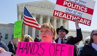 **FILE** Kathy Hansen, a family practice doctor in Houston, protests President Obama's health care law outside the Supreme Court on March 27, 2012. The justices were listening to arguments on the law's individual mandate. (The Washington Times)