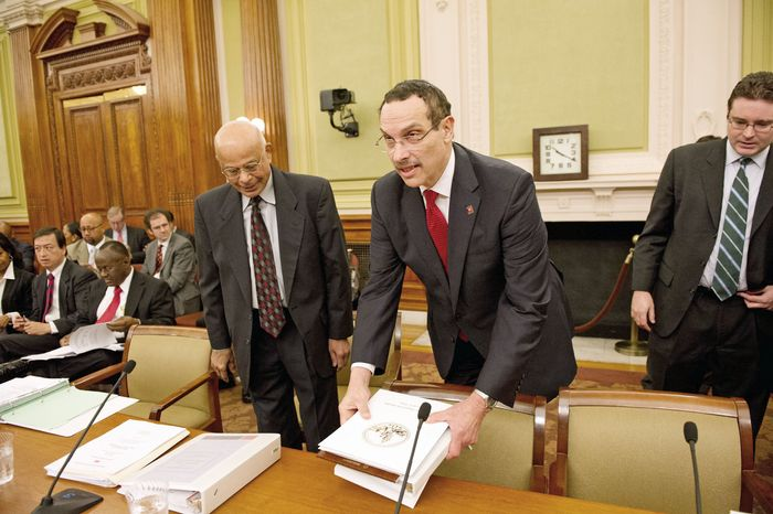 Before the D.C. Council on Tuesday, (from left) Chief Financial Officer Natwar M. Gandhi, Mayor Vincent C. Gray and budget director Eric Goulet arrive to testify on the mayor's fiscal 2013 budget. Mr. Gray's budget proposal would close a $172 million gap through $102 million in cuts and $70 million in new revenue. (Andrew Harnik/The Washington Times)