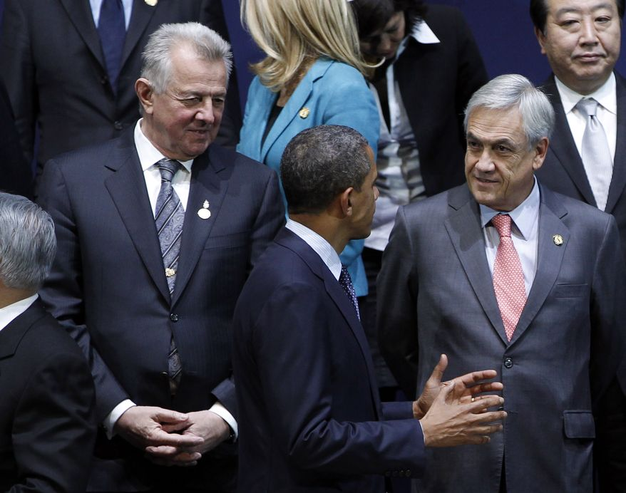 President Obama (center) speaks to Chilean President Sebastian Pinera (right) on March 27, 2012, prior to a group photo session at the Nuclear Security Summit in Seoul. (Associated Press)