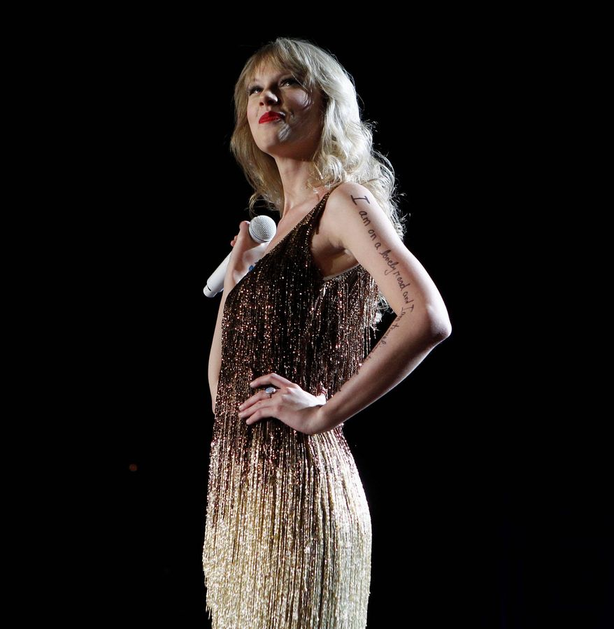 Taylor Swift performs on stage at the Burswood Dome during the opening night of her 'Speak Now' Australian tour in Perth, Australia, Friday, March 2, 2012. Swift will perform in Perth, Adelaide, Brisbane, Sydney, Melbourne and Auckland New Zealand. (AP Photo/Theron Kirkman)