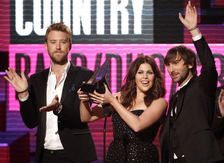 The members of Lady Antebellum - Charles Kelley, Hillary Scott and Dave Haywood (from left) - will perform a benefit concert in Henryville, Ind., which was heavily damaged by tornadoes on March 2. The group will also appear at a prom event on the same day as the concert, May 16. (Associated Press)