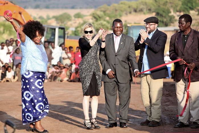 Madonna prepares to cut the ribbon at the October 2009 groundbreaking for the Raising Malawi Academy for Girls in Lilongwe, Malawi. Her foundation has since announced that instead of building the academy, it will donate money for 10 schools in the country. (Associated Press)