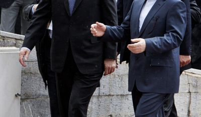 Iranian Vice President Mohammad Reza Rahimi (right) speaks with Turkish Prime Minister Recep Tayyip Erdogan in Tehran on Wednesday. Mr. Erdogan visited to discuss Iran's disputed nuclear program. (Associated Press)
