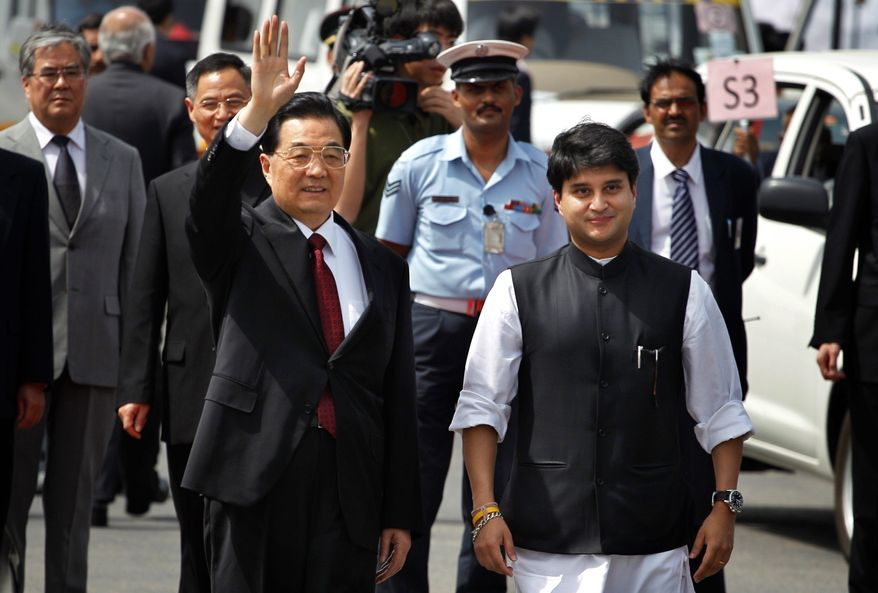 Chinese President Hu Jintao (left) is met by Jyotiraditya Scindia, India's commerce minister, as he arrives in New Delhi Wednesday to attend the fourth summit of rising nations known as BRICS. They want more influence in Western institutions. (Associated Press)