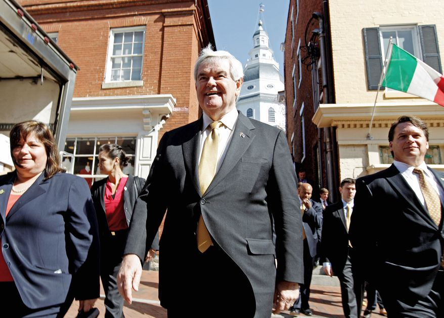 Former House Speaker Newt Gingrich walks the streets of Annapolis during a visit to the Maryland State House on Tuesday. The Republican presidential hopeful, who has cut his campaign staff, was in the state in advance of the April 3 presidential primary. (Associated Press)