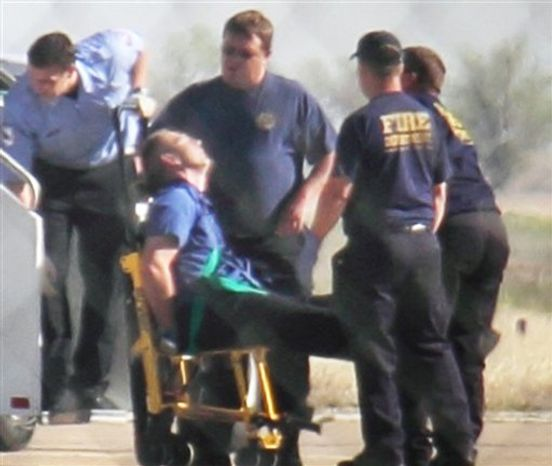 "** FILE ** Emergency workers tend to a JetBlue captain that had a ""medical situation"" during a Las Vegas-bound flight from JFK International airport, Tuesday, March 27, 2012, in Amarillo, Texas. Passengers said the pilot screamed that Iraq or Afghanistan had planted a bomb on the flight, was locked out of the cockpit, and then tackled and restrained by passengers. (AP Photo/Steve Douglas)"