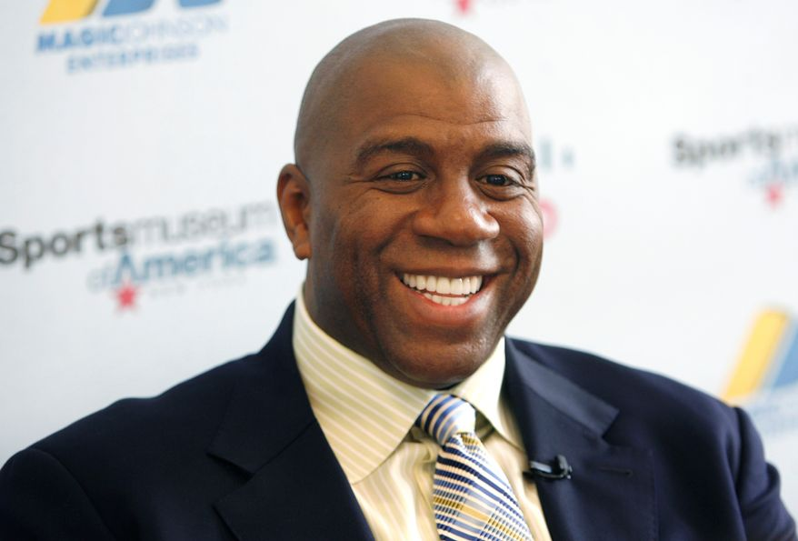 FILE - In this Nov. 21, 2008 file photo, basketball legend turned entrepreneur Magic Johnson tours the Sports Museum of America in New York. A group that includes former Lakers star Magic Johnson and longtime baseball executive Stan Kasten agreed Tuesday, March 27, 2012 to buy the Los Angeles Dodgers from Frank McCourt for $2 billion. (AP Photo/Seth Wenig, File)