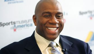 Basketball legend turned entrepreneur Magic Johnson tours the Sports Museum of America in New York, Friday, Nov. 21, 2008. A group that includes former Lakers star Magic Johnson and longtime baseball executive Stan Kasten agreed Tuesday night March 27, 2012, to buy the Los Angeles Dodgers from Frank McCourt for $2 billion. (AP Photo/Seth Wenig)