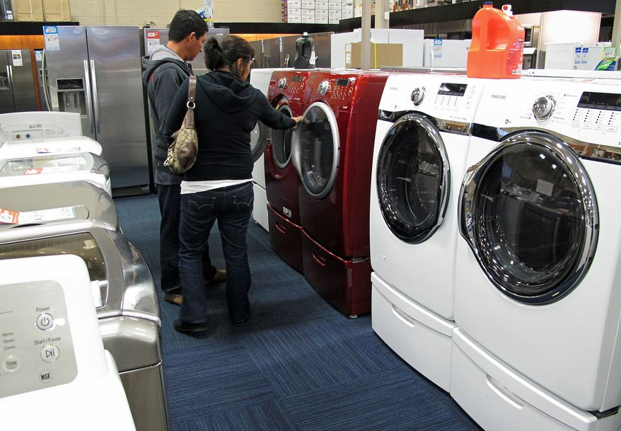Customers shop for laundry appliances at Pacific Sales Kitchen & Home Center at the Best Buy store in Glendale, Calif., on Monday, Feb. 27, 2012. (AP Photo/Damian Dovarganes)