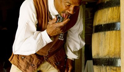 Mount Vernon Lead Historic Interpreter Peter Curtis tastes whiskey as  comes out of a distiller. (Andrew Harnik/The Washington Times)