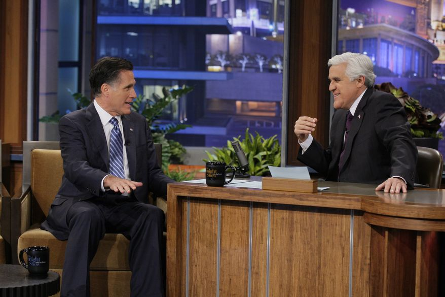 """Republican presidential candidate Mitt Romney talks with Jay Leno during his appearance on NBC's """"The Tonight Show"""" in Burbank, Calif., on Tuesday, March 27, 2012. (AP Photo/NBC, Paul Drinkwater)"""