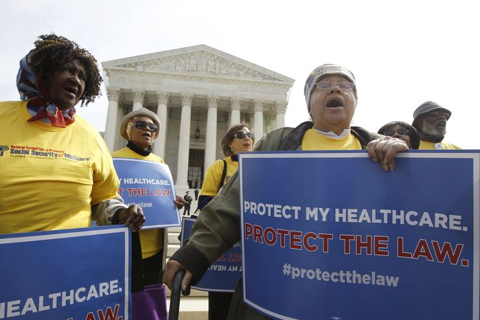 Supporters of health care reform rally in front of the U.S. Supreme Court in Washington on Wednesday, March 28, 2012, the final day of arguments over the health care law signed by President Obama. (AP Photo/Charles Dharapak)