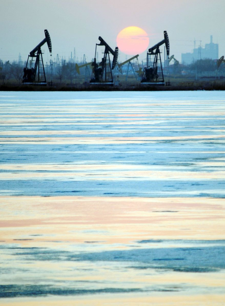 Rigs belonging to PetroChina pump oil near the banks of a snow-covered lake in Daqing in northeastern China's Heilongjiang province. Exxon Mobil is pumping less oil than PetroChina, a company formed just 13 years ago by the Chinese government to better compete for the world's oil and natural gas. (Associated Press)
