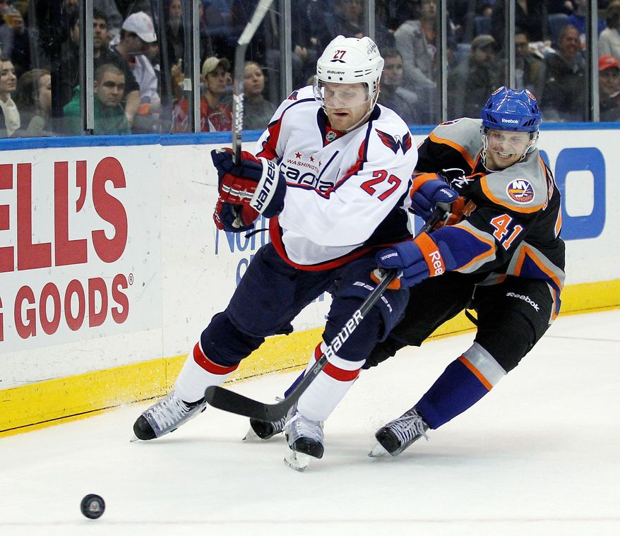 """Capitals defenseman Karl Alzner (27), shadowing the New York Islanders' David Ulstrom, said, """"We're going to have to be a desperate hockey team, every single second of every game."""" (Associated Press)"""