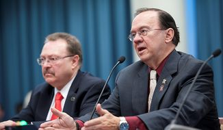 "Skip Coburn (right), executive director of the D.C. Nightlife Association, urges a D.C. Council committee during a hearing Thursday to consider extending hours that bars and restaurants can serve alcohol. ""We have a 24-hour city, we have a 24-hour world,"" he says. Mayor Vincent C. Gray has proposed the change. (Barbara L. Salisbury/The Washington Times)"