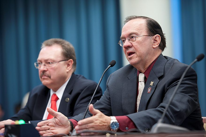 """Skip Coburn (right), executive director of the D.C. Nightlife Association, urges a D.C. Council committee during a hearing Thursday to consider extending hours that bars and restaurants can serve alcohol. """"We have a 24-hour city, we have a 24-hour world,"""" he says. Mayor Vincent C. Gray has proposed the change. (Barbara L. Salisbury/The Washington Times)"""