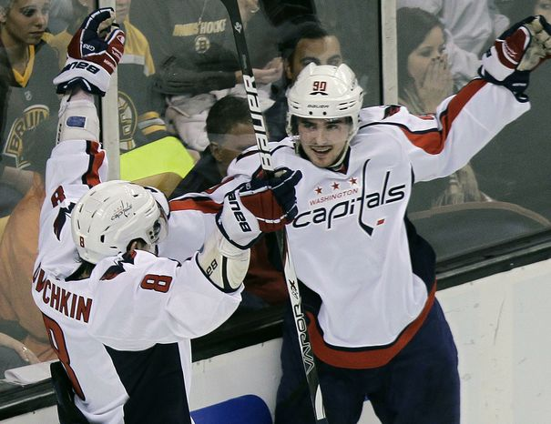 Washington Capitals center Marcus Johansson (90), of Sweden, celebrates his goal with teammate Alex Ovechkin (8), of Russia, who assisted in the third period of an NHL hockey game against the Boston Bruins in Boston, Thursday, March 29, 2012. (AP Photo/Elise Amendola)
