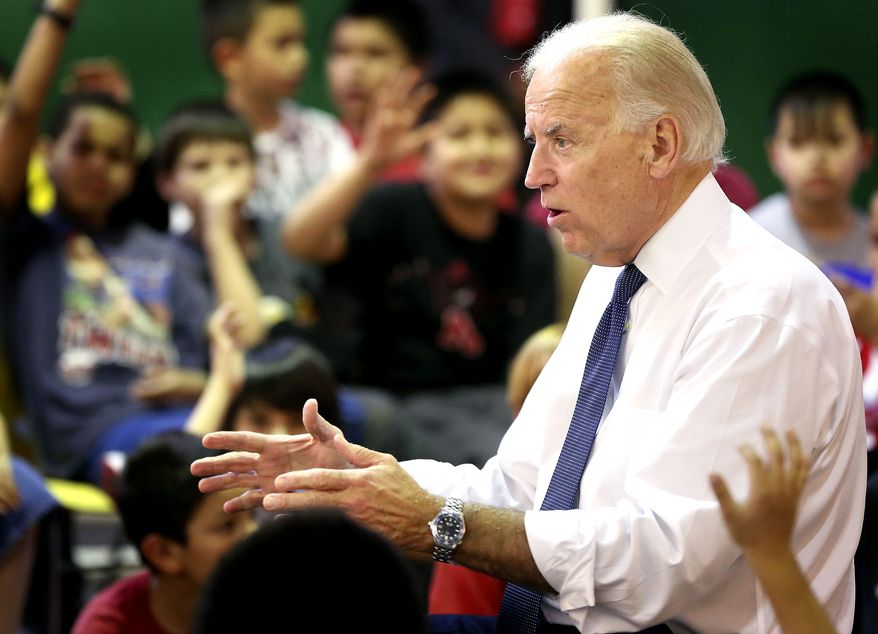 Vice President Joseph R. Biden Jr., talks March 28, 2012, to students during his stop at the Boys Club in Sioux City, Iowa. (Associated Press/Sioux City Journal)
