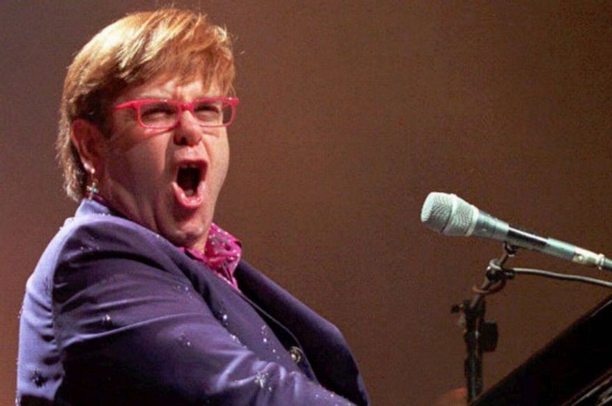 Elton John performs in Scotland, on Dec. 11, 1997.  (Associated Press)