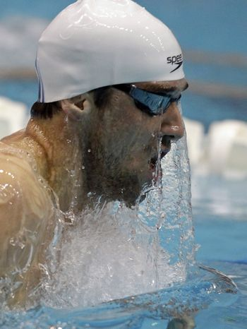 Michael Phelps competes in the men's 400-meter individual medley at the Indianapolis Grand Prix swimming meet Friday, March 30, 2012, in Indianapolis. Phelps won the event. (AP Photo/Darron Cummings)