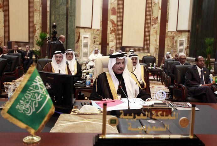 Ahmad al-Qattan (center), Saudi Arabia's permanent representative to the League of Arab States, attends the annual Arab League summit in Baghdad on March, 29, 2012. (Associated Press)