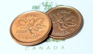 Pennies are shown in Ottawa on Thursday, March 29, 2012. The humble one-cent piece is set to disappear from Canadian pockets, a victim of inflation. (AP Photo/The Canadian Press, Sean Kilpatrick)