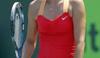 Maria Sharapova reacts after losing a point to Agnieszka Radwanska during the women's singles final at the Sony Ericsson Open tennis tournament in Key Biscayne, Fla., on Saturday, March 31, 2012. Radwanska won 7-5, 6-4. (AP Photo/Alan Diaz)