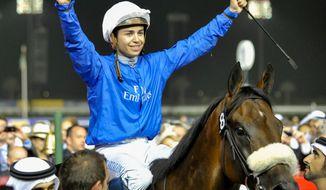 Mickael Barzalona celebrates on Monterosso after he won the Dubai World Cup race, Saturday, March 31, 2012, in Dubai, United Arab Emirates. (AP Photo/Stephen Hindley)