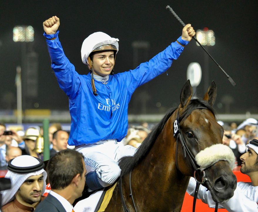 Mickael Barzalona celebrates on Monterosso after he won the Dubai World Cup race, Saturday, March 31, 2012, in Dubai, United Arab Emirates. (AP Photo/Stephen Hindley)