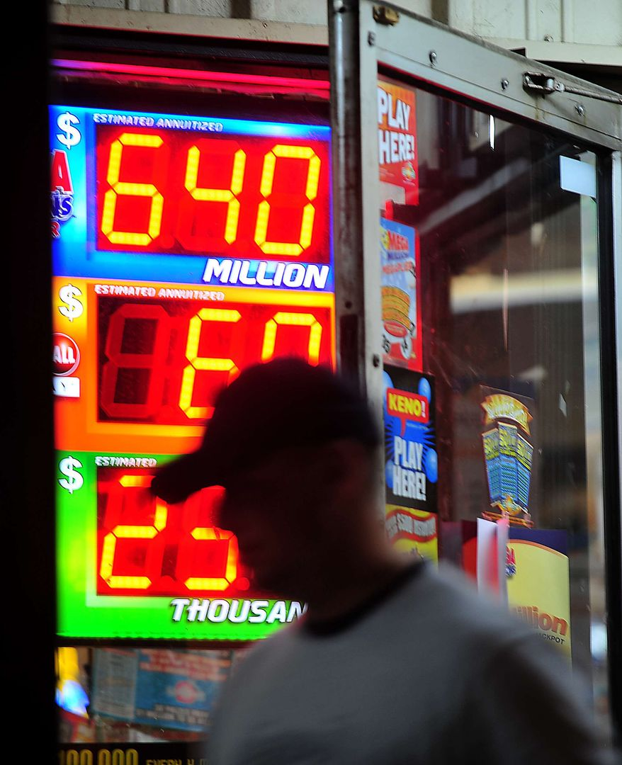 A customer walks out of the Riverside Travel Center in Hilton, Ga., late Friday night after purchasing a lottery ticket for the Mega Millions Lottery, which reached an estimated jackpot of $645 million for Friday night's drawing. (AP Photo/Jay Hare, The Eagle)