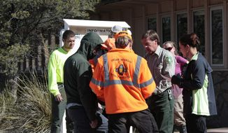 In this Friday, March 30, 2012, photo, provided by New Mexico Search and Rescue via Silver City Daily Press & Independent, search-and-rescue team members prepare to search for missing runner Micah True, in Silver City, N.M. (AP Photo/New Mexico Search and Rescue via Silver City Daily Press & Independent)