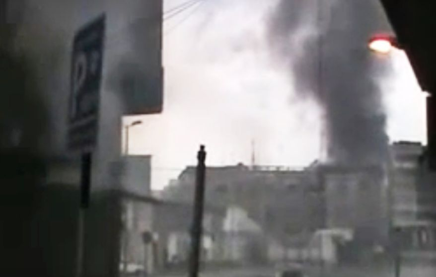 This image made from amateur video and released by the Syria media center Thursday, March 29, 2012, purports to show black smoke riding from buildings in Homs, Syria. The Associated Press cannot independently verify the content, date, location or authenticity of this material. (AP Photo/Syria Media Center via APTN)