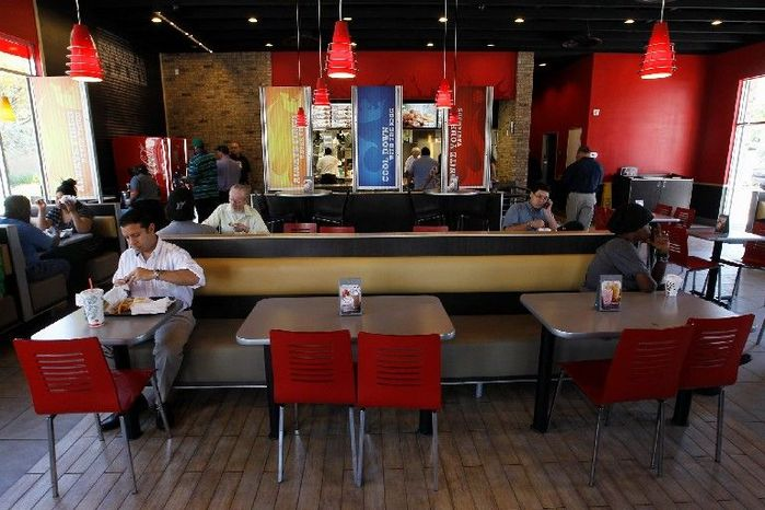 In this March 28, 2012 photo, patrons dine at a Burger King restaurant in Miami. On Monday, April 2, 2012, Burger King launches 10 menu items including smoothies, frappes, specialty salads and snack wraps in a star-studded TV ad campaign. It's the biggest menu expansion since the chain opened its doors in 1954. (AP Photo/Luis M. Alvarez)