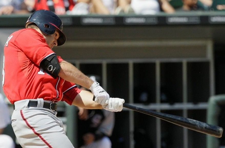 Nationals second baseman Danny Espinosa batted  just .223 left-handed last year, well below his .283 average from the right side. Spotting  a loop in Espinosa's swing, utility man Mark DeRosa suggested a drill that has helped  the switch-hitter  find a comfortable path for his bat. (Associated Press)